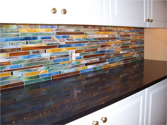 Fused glass tile backsplash. We crafted and assisted with the installation  of this 62 sq. ft. of horizontally running fused glass tiles in colors of  amber, ...